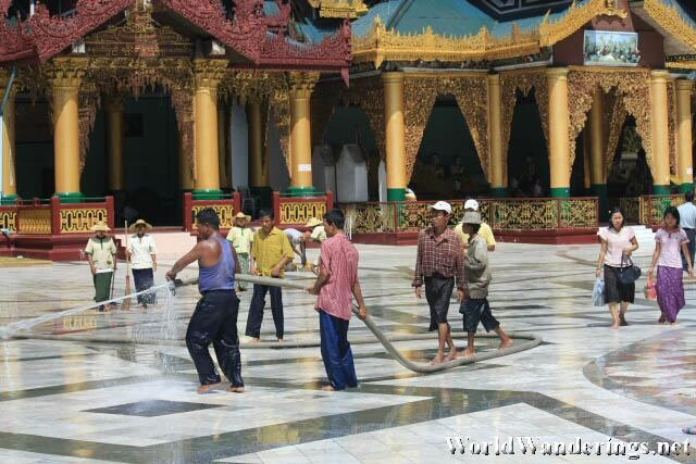Hosing the Marble Floors of the Shwedagon Paya