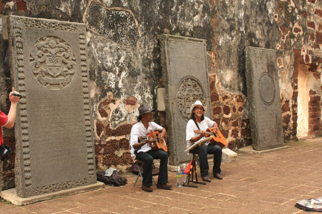 Buskers Amid the Tombstones at the Church of Saint Paul