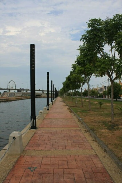 Promenade Along the Sungei Melaka, Eye on Malaysia in the Background