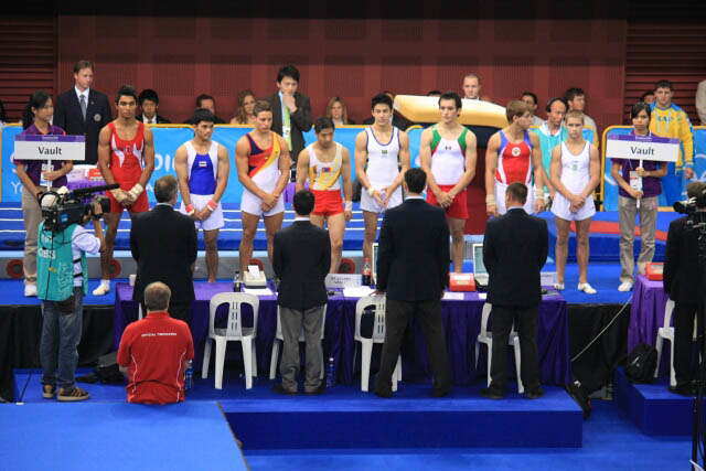 Male Gymnasts Presenting Themselves to the Judges