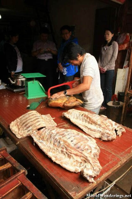 Carving Up Meat at the Market at Lijiang Ancient Town 丽江古城