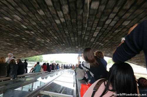 Going Under a Bridge at the Tour of the River Seine