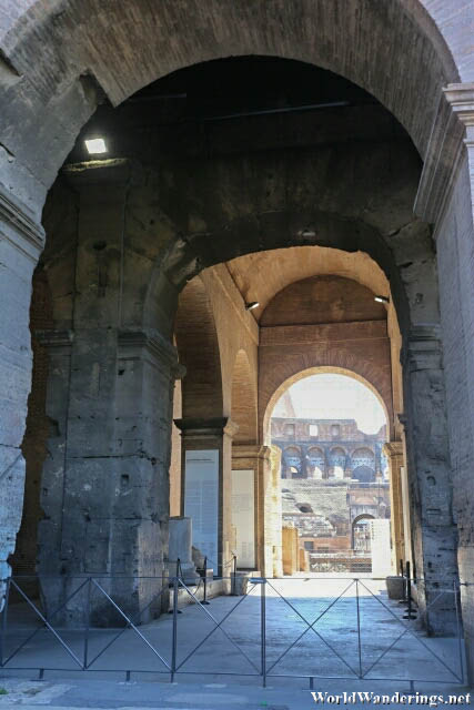 Peeking Through the Fence for a Glimpse of the Colosseum in Rome