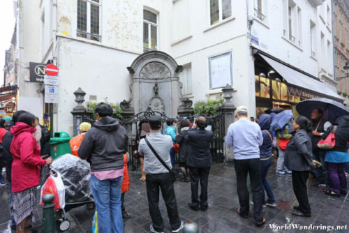 Tourists Gather Around the Menneken Pis in Brussels