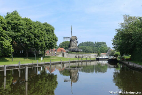 Windmill and a Canal in the City of Sloten