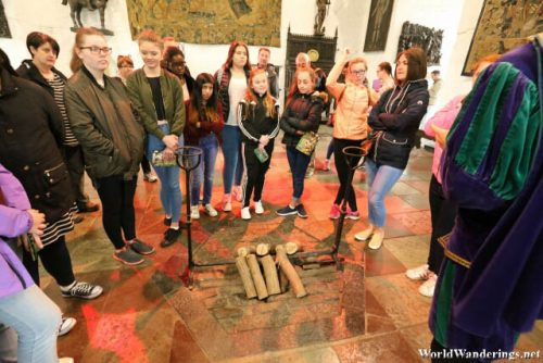 Visitors Gather Around the Guide at Bunratty Castle